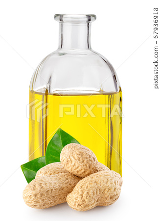 Peanuts with leaves and peanut oil in square bottle 67936918