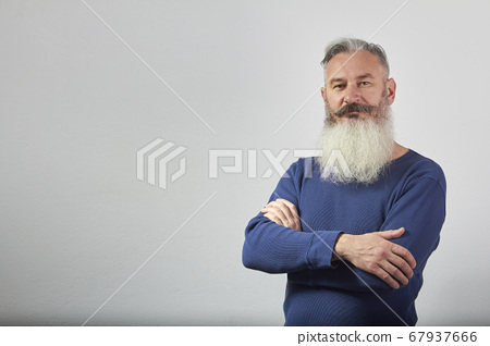 Portrait of mature gray-haired bearded man in blue 67937666