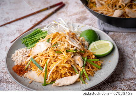 pan fried chicken pad thai with lime 67938458