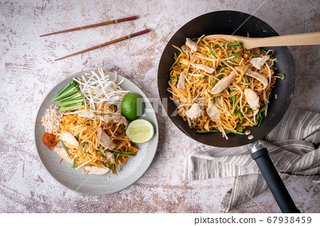pan fried chicken pad thai with lime 67938459
