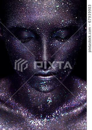 Beautiful girl with art space makeup on her face and body. Glitter Face. 67939983
