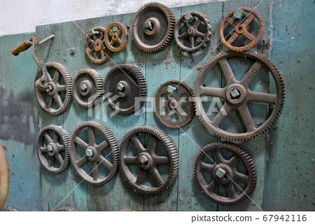Gears on wooden panel 67942116