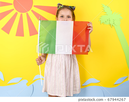 Little girl on a bright background with Italian flag. The concept of summer, beach holidays and 67944267