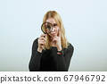 Focused Girl Looks Through Magnifying Glass, Big Eye. Concept Of Research, Study 67946792