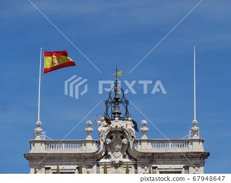 Spanish national flag under the blue sky 67948647