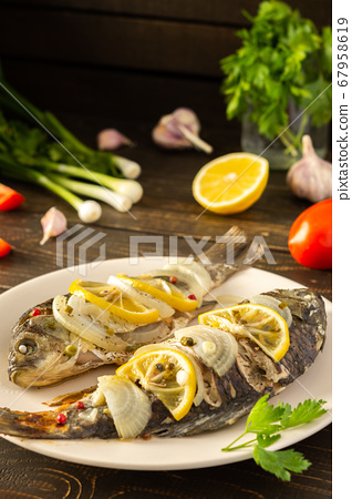 Cooked river fish carassius 67958619