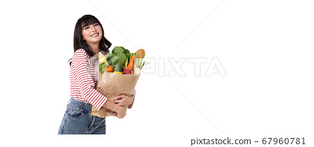 Happy smiling Asian woman holding paper shopping 67960781