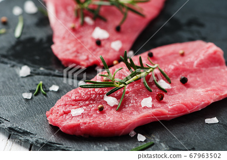 Uncooked meat with rosemary and salt 67963502