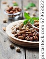 Mix of nuts on the wooden table 67963822