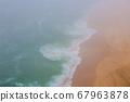 Sea and sandy beach in dense fog, autumn day 67963878