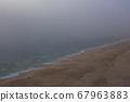 Sea and sandy beach in dense fog, autumn day 67963883