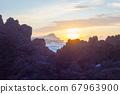 Lava stones on the beach of Piscinas Naturais Biscoitos. Atlantic Ocean. Terceira Azores, Portugal. 67963900