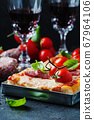 Pizza with salami and tomato 67964106