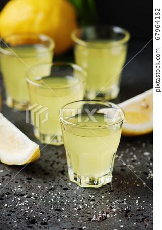 Italian traditional liqueur limoncello with lemon 67964182