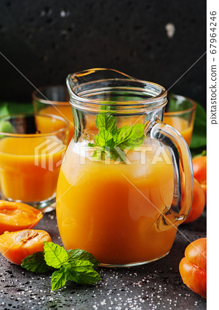 Fresh sweet apricot juice and mint 67964246