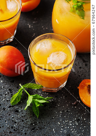 Fresh sweet apricot juice and mint 67964247