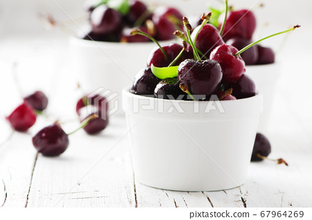 Sweet cherry on the wooden table 67964269