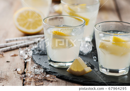 Homemade lemonade with lemon and ice 67964295