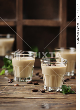 Cold cream with coffe and mint on the wooden table 67965927