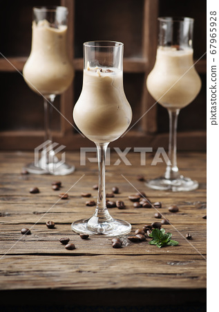 Cold cream with coffe and mint on the wooden table 67965928