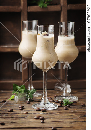 Cold cream with coffe and mint on the wooden table 67965929