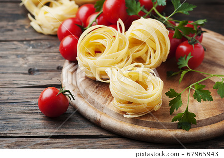 Ingredients for cooking pasta and tomato on the 67965943