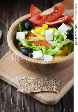 Fresh Greek salad with olive oil 67966204