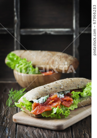 Healthy sandwich with cheese and salmon 67966283