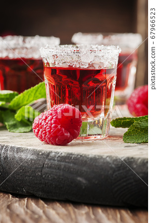 Red sweet cocktail with mint and raspberry 67966523