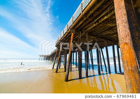 surfer by Pismo Beach pier 67969461