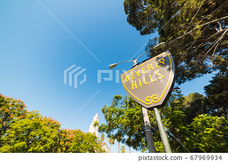 Beverly Hills sign under a blue sky 67969934