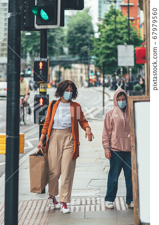 Mum and daughter in face mask are shopping 67979560