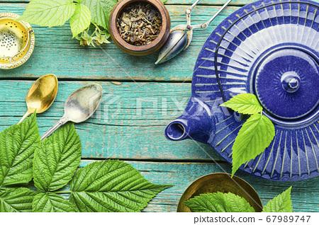Glass teapot with herbal tea 67989747