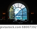 Glacier and lake view through the window of the Fairmont Chateau Lake Louise restaurant in Alberta, Canada 68007392