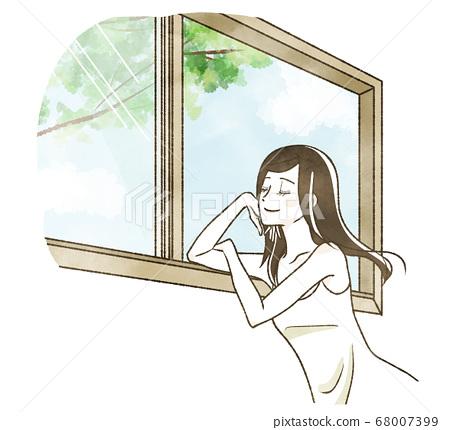 窗台上的女人閉著眼睛,感覺到風 68007399