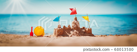 Sandcastle on the sea in summertime 68013580