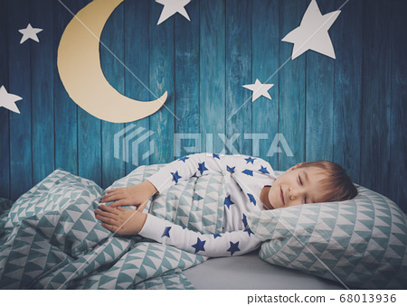 Five years old child sleeping in bed 68013936