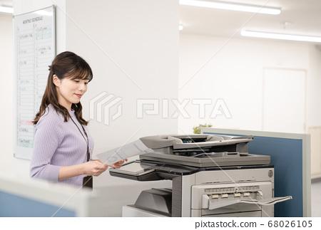 Female employee making a copy 68026105