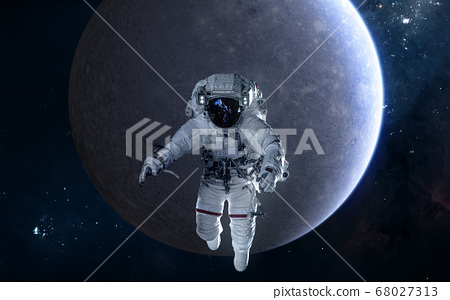 Astronaut on background of Mercury. Solar system 68027313