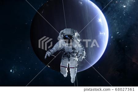 Astronaut on background of Uranus. Solar system 68027361