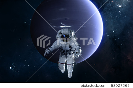 Astronaut on background of Neptune. Solar system 68027365