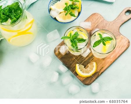 Fresh lemon lemonade in jug and glasses 68035764