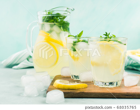 Fresh lemon lemonade in jug and glasses 68035765