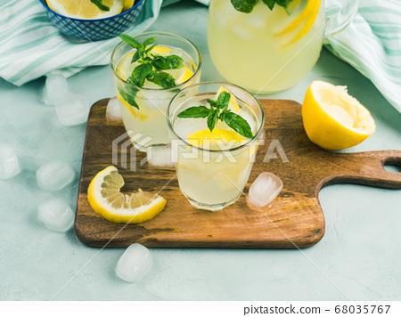 Fresh lemon lemonade in jug and glasses 68035767