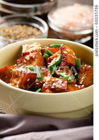 Close Up view at crispy fried tofu pieces with 68035786