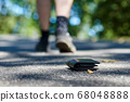 Photo of the sidewalk and legs of a man who lost a 68048888