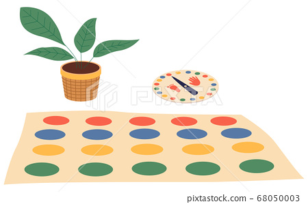 Twister game, indoor game at floor, carpet with colorful circles, color spinner for game, plant 68050003
