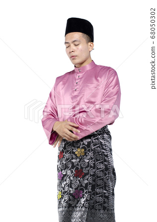 young fit man in sportswear , holding dumbbell over white background 68050302