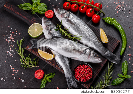 Fresh fish seabass and ingredients for cooking 68056277