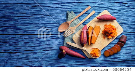 Sweet Potato on wooden cutting board and blank 68064254